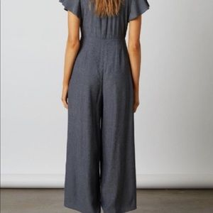 Tie-front flutter sleeve jumpsuit w/ side slits